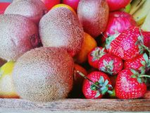 Fruits on wooden table Royalty Free Stock Images
