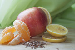 Fruits on the wooden table. аpple, lemon, tangerine, flax seeds Royalty Free Stock Images