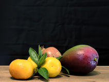 Fruits on wooden table Stock Photography