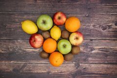 Fruits on wooden table - Vegetarian food.  royalty free stock images