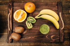 Fruits on wooden tray closeup, nobody, top view. Fresh raw fruits on wooden tray closeup, nobody, top view. Healthy food concept. Organic nutrition Royalty Free Stock Photo