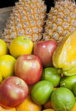 Fruits in woody tray. Pineapple, apple, star fruit, lemon and orange in woody tray Stock Photography