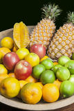 Fruits in woody tray. Pineapple, apple, star fruit, lemon and orange in woody tray Stock Photos