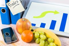 Fruits on workplace Stock Image