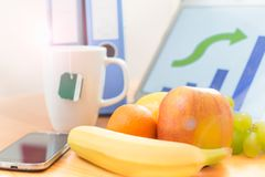 Fruits on workplace Stock Photos