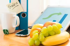 Fruits on workplace Stock Images