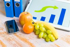 Fruits on workplace Stock Photography