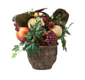 Fruits in Xmas centerpiece. Various fruits in an arrangment in a vase for Christmas decoration royalty free stock image