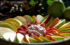 Fruits and yoghurt. One apple, one pear and four average sized strawberries diced with a strawberry yoghurt center Stock Photos