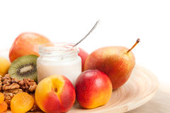 Fruits and yogurt on the dish Stock Photography