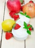 Fruits and yogurt Stock Image