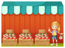 A fruitstand with a young girl Royalty Free Stock Photography
