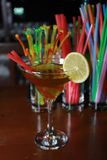 Fruity alcoholic cocktail with straw, lemon and garnish. Colorf Stock Images