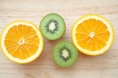 Fruity background set of slices of orange fruit and kiwi Stock Photos