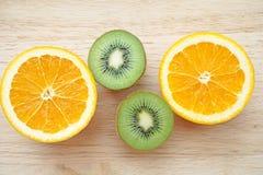 Fruity background set of slices of orange fruit and kiwi Stock Photos