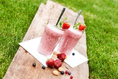 Fruity berry milkshake outdoors Royalty Free Stock Photography