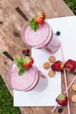 Fruity berry milkshake outdoors Royalty Free Stock Images