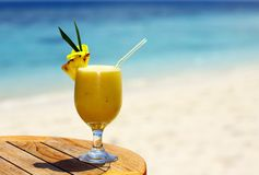 Fruity cocktail. Bocal of fruity cocktail on a beach table Royalty Free Stock Photos