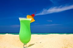 Fruity cocktail is on a beach Stock Image