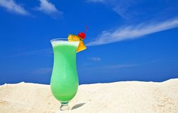 Fruity cocktail is on a beach Stock Photo