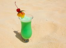 Fruity cocktail is on a beach Stock Images