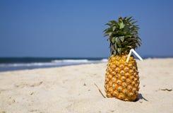 Fruity cocktail on the beach sand Stock Photo