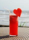 Fruity cocktail on a beach table Stock Photography