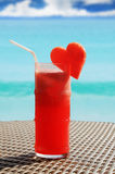 Fruity cocktail on a beach table Royalty Free Stock Photo