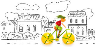 Fruity cyclist. Fruits and vegetables in the shape of a female cyclist riding a bike in the city Stock Photo