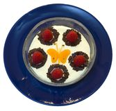Fruity dessert. Healthy dessert made of yoghurt and fruits, ornaments resembling a butterfly royalty free stock image