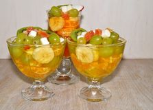 Fruity dessert - jelly with fruit in a glass bowl Stock Image