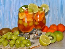 Fruity dessert -  - jelly with fruit in a glass bowl and fresh fruits Royalty Free Stock Photos