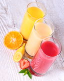 Fruity drinks juice from banana, tangerine, strawberry Royalty Free Stock Photography