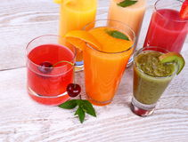 Fruity drinks juice from cherry, kiwi, tangerine Stock Images