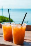 Fruity Drinks. Red Fruity Drinks by the Ocean Royalty Free Stock Photography