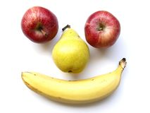 Fruity face. A funny fruit face with two apples, a pear and a banana Stock Photography