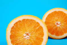 Fruity and Fun. Bright juicy oranges on a blue background Royalty Free Stock Photos