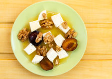 Fruity honey salad with cheese. On wooden table Royalty Free Stock Photos