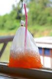Fruity ice tea. Bag of ice tea with a lemon on top Royalty Free Stock Photos