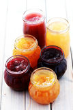 Fruity jam. Different jars full of fruity jam - food and drink Royalty Free Stock Images