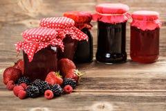 Fruity jam. Different jars full of fruity jam Stock Images
