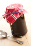 Fruity jam in glass jar Stock Photography