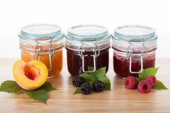 Fruity jams in jars Stock Image