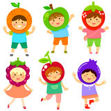 Fruity kids. Cute kids dressed like fruit Royalty Free Stock Image