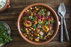 Fruity lamb tagine. Lamb tagine with chickpeas, apricots and pomegranate seeds Royalty Free Stock Image