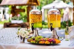 Fruity lemonade, fruit refreshing drink, orange juice, catering, Royalty Free Stock Photos