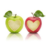 Fruity Love. Two apples with heartshaped parts staring at viewer Royalty Free Stock Photo