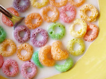 Fruity o cereal. In yellow bowl with milk and spoon Stock Image