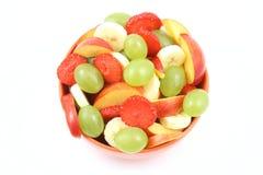 Fruity salad. Bowl of fruity salad - banana strawberry nectarine and grape - isolated on white Royalty Free Stock Photography