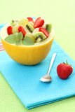 Fruity salad. In cantaloupe - delicious dessert Royalty Free Stock Photo